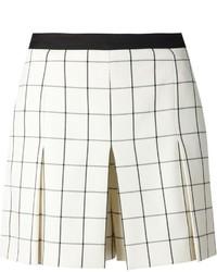 Pantalones cortos a cuadros en beige