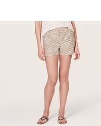 Pantalones cortos a lunares en beige
