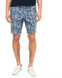 Pantalones cortos con print de flores azules