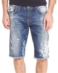 Pantalones cortos desgastados celestes