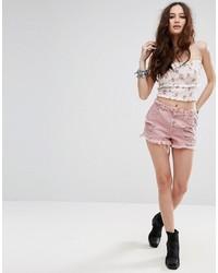 Pantalones cortos vaqueros desgastados rosados de Missguided