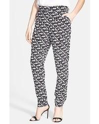 Pantalones pitillo con estampado geométrico grises