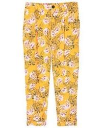 Pantalones pitillo con print de flores amarillos de Mango