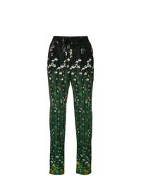 Pantalones pitillo con print de flores verdes de RED Valentino