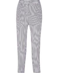Pantalones pitillo de rayas verticales en blanco y azul marino de Equipment