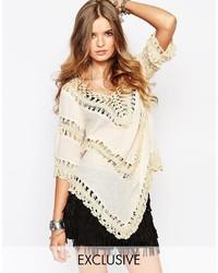 Poncho de crochet marrón claro