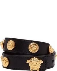 Pulsera de cuero en negro y dorado de Versace