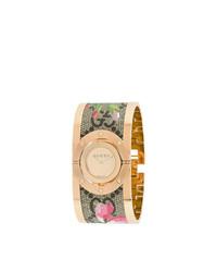 Reloj con print de flores dorado de Gucci