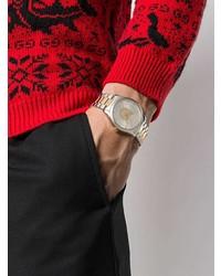 Reloj dorado de Gucci