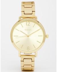 Reloj dorado de Oasis