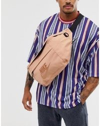 Riñonera de lona rosada de Nike