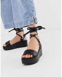 Sandalias con cuña de cuero negras de RAID