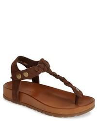 Sandalias de dedo de cuero en marrón oscuro