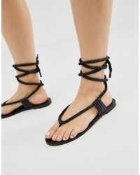 Sandalias de dedo de cuero negras de Eeight