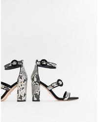Sandalias de tacón de cuero con print de serpiente grises de Faith