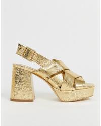 Sandalias de tacón de cuero doradas de Head over Heels by Dune