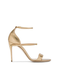 Sandalias de tacón de cuero doradas de Jennifer Chamandi