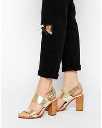 Sandalias de tacón de cuero doradas de London Rebel
