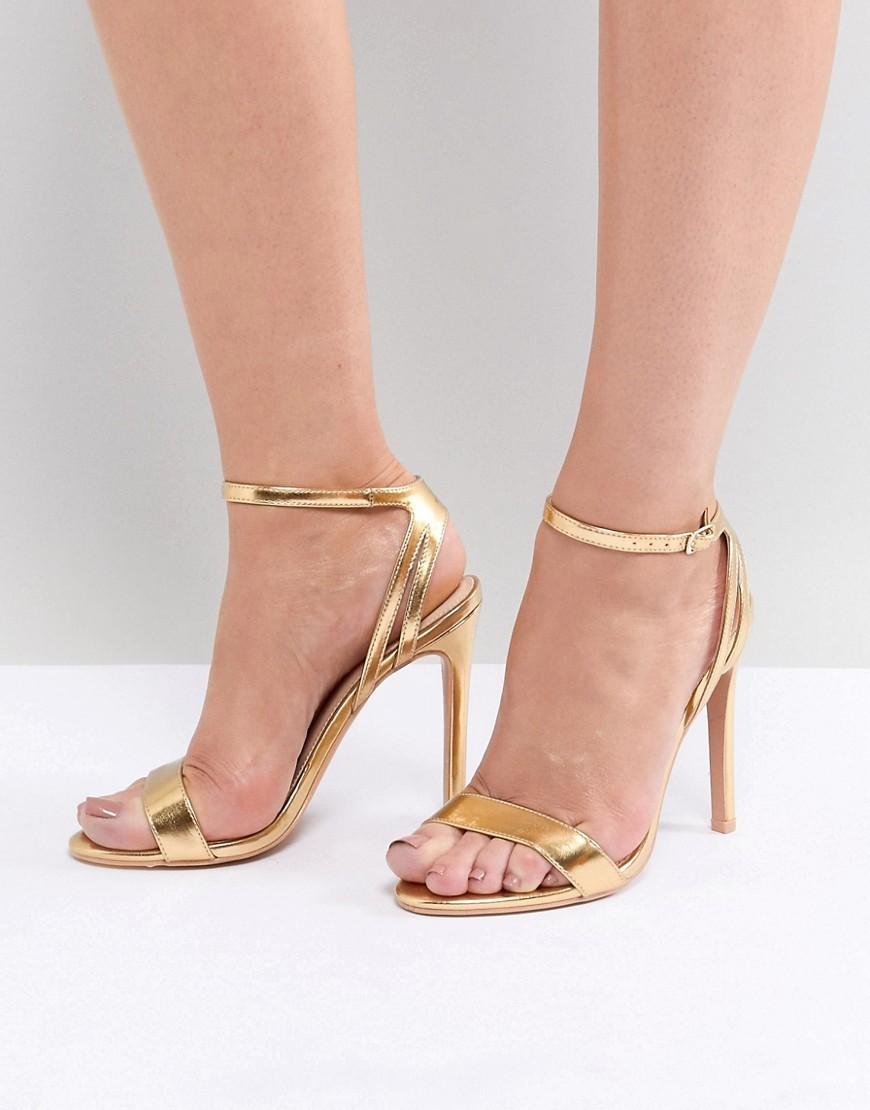 Sandalias de tacón de cuero doradas de Public Desire