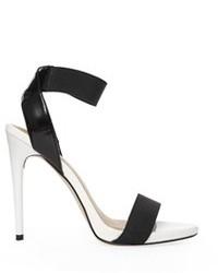 Sandalias de tacón de cuero en negro y blanco de Asos