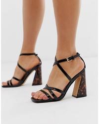 Sandalias de tacón de cuero negras de Head over Heels by Dune