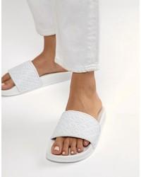 Sandalias planas de cuero blancas de Slydes