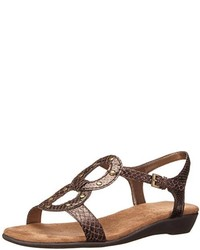 Sandalias planas de cuero con print de serpiente marrónes