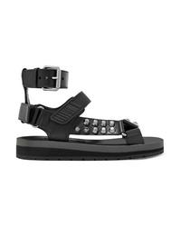Sandalias planas de cuero con tachuelas negras de Prada