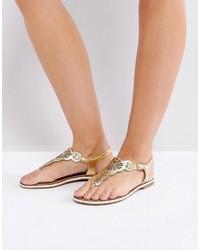 Sandalias planas de cuero doradas de Dune