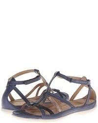 Sandalias planas de cuero en gris oscuro