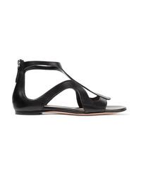 Sandalias planas de cuero negras de Alexander McQueen