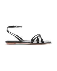 Sandalias planas de cuero negras de Prada