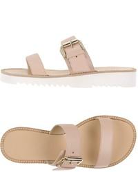 Sandalias planas de cuero rosadas
