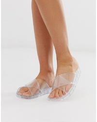Sandalias planas de goma transparentes de ASOS DESIGN