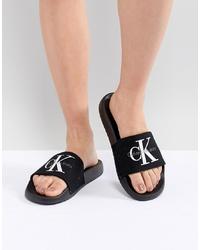 Sandalias planas de lona bordadas negras de Calvin Klein