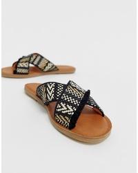 Sandalias planas de lona bordadas negras de Toms