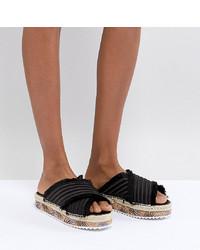 Sandalias planas de satén negras de Sixtyseven
