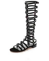 Sandalias romanas altas de ante negras de Stuart Weitzman
