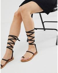 Sandalias romanas de cuero negras de RAID