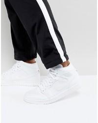 Tenis de cuero blancos de Jordan