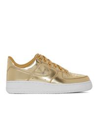 Tenis de cuero dorados de Nike