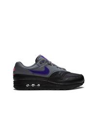 Tenis de cuero en gris oscuro de Nike