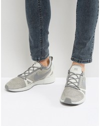 Tenis de lona grises de Nike