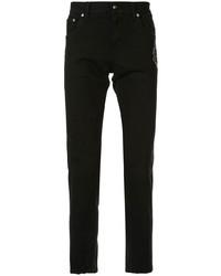 Vaqueros pitillo bordados negros de Dolce & Gabbana