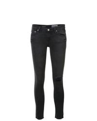 Vaqueros pitillo desgastados en gris oscuro de AG Jeans