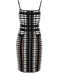 Vestido ajustado a cuadros en negro y blanco de Herve Leger