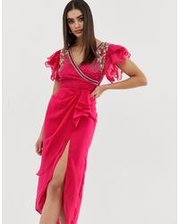 Vestido cruzado con adornos rosa de Virgos Lounge