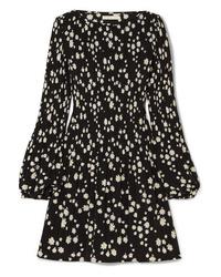 Vestido de vuelo con print de flores negro de Maje