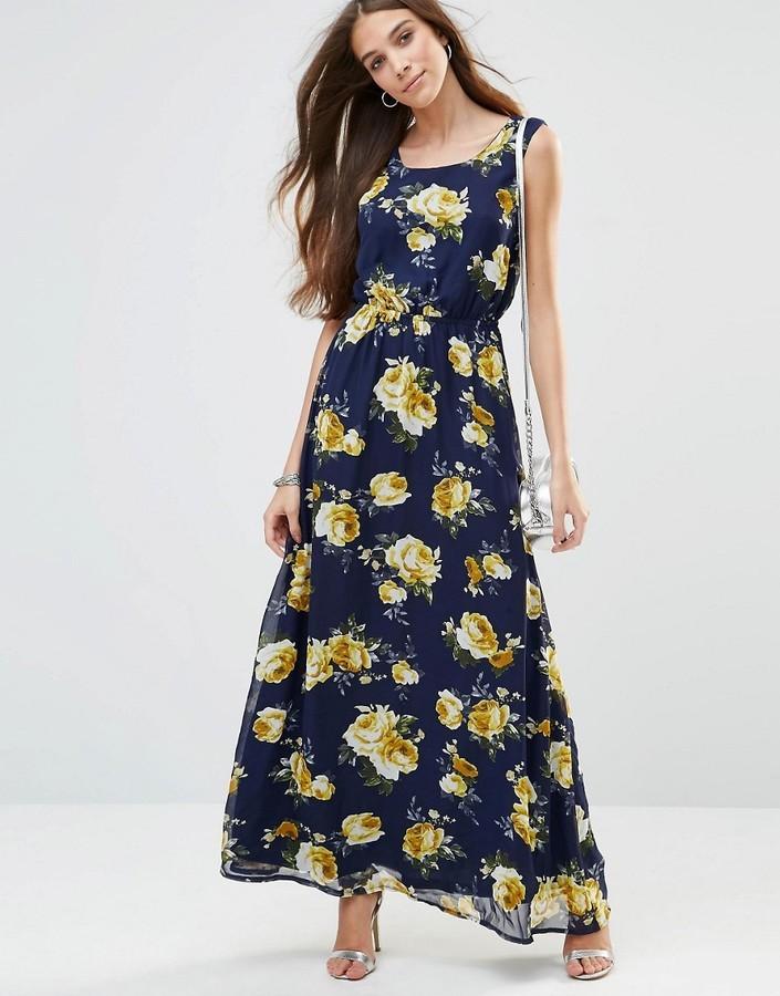 7074a6577 ... Vestido largo con print de flores azul marino ...