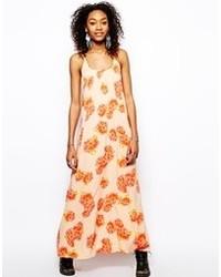 Vestido largo con print de flores en beige